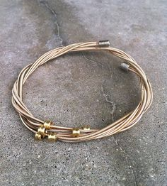Recycled Guitar String Bracelet by eye on the sparrow on Scoutmob Shoppe