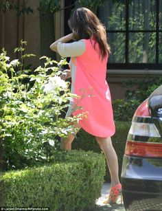 Kourtney Kardashian wearing Sophia Webster Yayoi Neon Patent Leather and Suede Sandals and Cameo the Resistance Dress in Hot Pink.