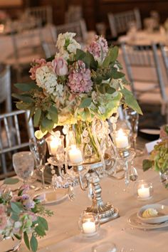Crystal and candelabra wedding centerpieces at this ballroom wedding in Northville, Michigan