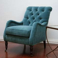Peacock Blue Velvet Tufted Club Chair -- good style, nice color, like the dark wood legs