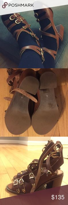 Jeffrey Campbell Buckle strapped sandals Jeffrey Campbell Free People brand buckle strapped sandals. Stacked heels. Very cute when worn with stockings or socks in the Fall season. Let me know if you have any questions. Gently worn indoors once. Excellent condition. Free People Shoes Heels