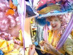 """Laissez les bon temps roulez,"" reads Marie Antoinette's hat. Jenny Singsaas of Burbank, California, has made her costume for the five years that she has attended the Society of St. Anne parade. ""The most wonderful thing happens on that Tuesday,"" says Singsaas. ""There are people you only see once a year, that day, in costume, but you recognize each other and are great friend"
