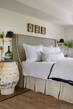 ASHLEY GILBREATH INTERIOR DESIGN: Lots of texture in this Rosemary Beach master bedroom! A white diamond quilted coverlet, black and tan patterned upholstered headboard, and antique jug nightstands are flanked by antique brass swing arm wall lamps. Ashley Gilbreath, Swing Arm Wall Lamps, Rosemary Beach, Diamond Quilt, Nightstands, Antique Brass, Master Bedroom, Cottage, Texture