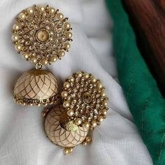 Looking for Jhumka design images? Here are our picks of jhumka models that will go well with any outfit. Indian Bridal Jewelry Sets, Indian Jewelry Earrings, Fancy Jewellery, Jewelry Design Earrings, Indian Jewellery Design, Gold Earrings Designs, Navy Earrings, Jhumka Designs, Jewellery Sale