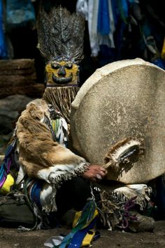 horned antlers Shaman:  Mongolian Shaman.  large drum and drumsticks  http://streetshamans.com