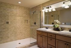 Doorless Shower-  very  cool. The mirror frame and vanity not matching is cool too.