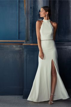 BHLDN Montreal Dress Channel your inner Meghan Markle with this sleek and sophisticated crepe dress featuring a high-neck and deep slit. This item is available for try-on in all stores; book an appointment at your local BHLDN shop.Only available at BHLDN Plain Wedding Dress, Perfect Wedding Dress, High Neck Wedding Dresses, Elegant Wedding, Dream Wedding, Bridal Dresses, Wedding Gowns, Bhldn Wedding, Wedding Bands