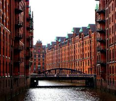 city of warehouses) in Hamburg, Germany is the largest warehouse district in the world where the buildings stand on oak logs along canals near the Elbe. The distri… Hamburg City, Hamburg Germany, Great Places, Places To See, Beautiful Places, Amazing Places, Travel Around The World, Around The Worlds, Famous Castles