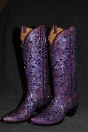 I live in the country, but I am not by any means, a country girl. I simply wear cowboy boots with my sun dresses because it's cute. These are $2000.00! Holy crap.