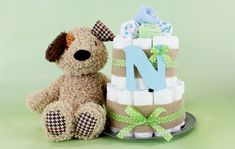 This adorable diaper cake is the perfect centerpiece for a baby shower. Diy Diaper Cake, Diy Cake, Campfire Cupcakes, Bountiful Baby, Easy Thanksgiving Crafts, Gift Card Balance, Create And Craft, New Kids, Holiday Treats