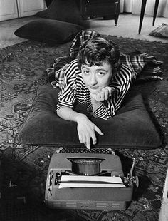 "French author Françoise Sagan tries some one-finger typing at her flat in Paris, Photograph: Thomas McAvoy/Time & Life Pictures/Getty Images. ""I always wanted to ask people: ""Are you in love? What are you reading?"" ― Françoise Sagan, A Certain Smile Book Writer, Book Authors, Françoise Sagan, Writers And Poets, Playwright, Screenwriter, Life Pictures, Bernard Shaw, Being A Writer"