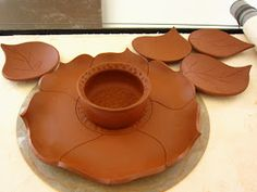 "It came together just like I hoped :)    14"" slab platter made from Hawaiian Red Clay.      The dipping bowl is wheel thrown.  I stamped t..."