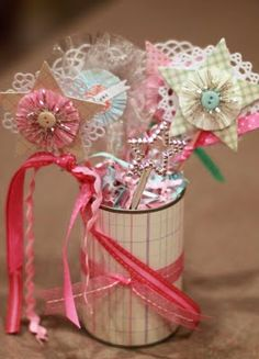 Baby Shower centerpieces using a can, ribbon, scrap paper, wooden skewers, and little embellishments.
