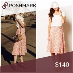 Anthropologie Petaluma Midi Skirt I am in love with this skirt. Rare & hard to come by. Label is HD by Paris. Only worn once. Not sure if I want to sell or not yet which is why price is higher. Will post real life pictures tomorrow! Anthropologie Skirts Midi