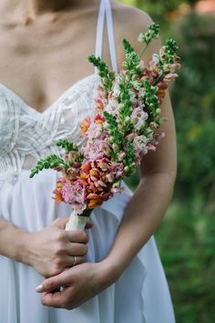 We LOVE everything from this bride's bouquet to her wedding dress.