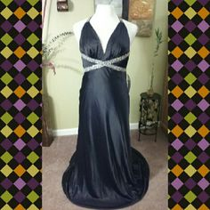 BLACK ICE GOWN Black satin fabric with cris-cross jeweled back straps,  side zipper and gathered back drop, v front neckline. This gown is great for any special occasion be the conversation piece at your next event. Dave  & Johnny Dresses Prom