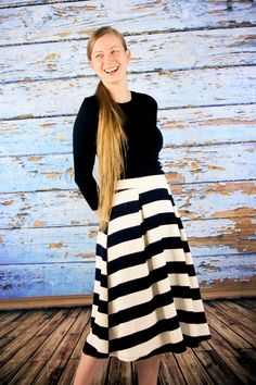 women's high-waist knee-length skirt with a pleated, A-Line finish. It features a nautical-inspired contrasting stripe print that never goes out of style. It is lightweight and comfortable, and can be worn for any casual events.