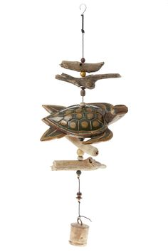 "TheSea Turtle is carved from solid coconut wood and finished on top and bottom with accents of driftwood and bell at bottom.  Measures: 35"" L x 11"" W  Sea Turtle Mobile by Cohasset Gifts. Home & Gifts - Home Decor - Outdoor Florida"