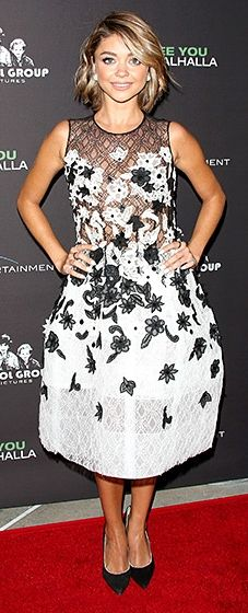 The Modern Family actress debuted her new film in a black and white Oscar de la Renta dress with strategic floral embellishments, plus pearl-encrusted Nicholas Kirkwood heels and diamond earrings.