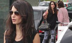 Amal Alamuddin wows in camouflage-print skinnies in Milan
