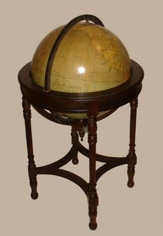 Weber Costello 18-Inch Sheraton Style Floor Globe c. 1930-40. The gores (maps on the globe's surface) were printed by the London firm of G.W. Bacon, imported and manufactured into the globe by American firm Weber Costello. The stand is in a style referred to as Sheraton style after the 18th C. London cabinetmaker Thomas Sheraton.  This globe was probably intended for home use and made by a high-end furniture maker.