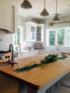 Custom Kitchen With Herb Garden Built Ins In The Island