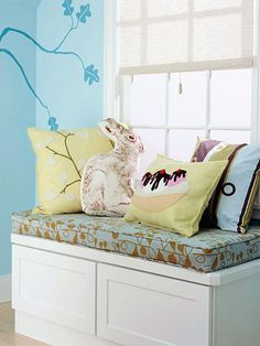 Quick Change  A peek inside this bench shows off ample storage for an overflow of toys or blankets and bedding. Make a bench like this using cabinets usually designated for the kitchen.