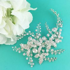 This dramatic clip features sparkling Swarovski rhinestones with accents of cream glass pearls that is the perfect accessory for the bride