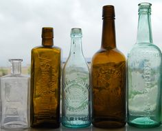 i have an aqua beer bottle collection requiring research and then the perfect dispay