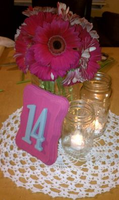Centerpiece Mock Up -- I like the mix of jars, kinda goes with our theme