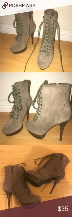 Steve Madden Ankle boots Suede material bootie from Steve Madden. Laces are a brighter green.  There is a picture of the bottom to show how new they are. There is a small mark on one of the boots as pictured. But barely visible. Laces are long and could be tied or tucked inside. No other damages to the shoe. Steve Madden Shoes Ankle Boots & Booties