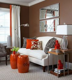 Decorating with Orange. Loving the mirrors! Great colour mix and sitting area for home office.