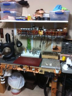 Leather work bench....check out the leather tool holder on lip of bench MXS