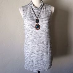 I just added this to my closet on Poshmark: Loft Gray Sleeveless Top Size S. Price: $15 Size: S