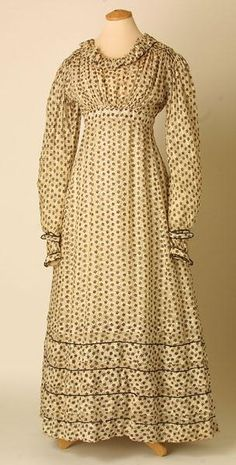 dress  1823-1825 Acknowledgement: © Manchester City Galleries Day frock of white horizontally striped India muslin printed with black floral pattern. Wide round neck trimmed with puffed bias band. Fastening with drawstring and two hooks and eyes at cotton-lined waistband. Long sleeves with narrowing wrists, fastening with hook and eye.
