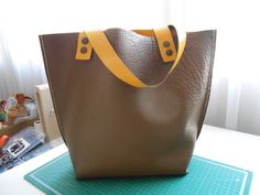 two sided leather tote, external hand stitching