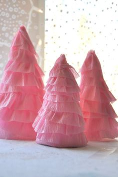crepe paper Christmas trees....would be cute in girls rooms...could do white or candy cane style