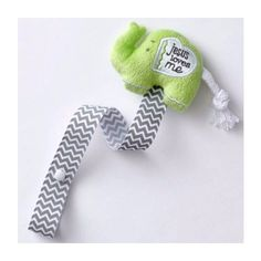 """Keep baby's pacifier close at hand and easy to find with this adorable """"Jesus Loves Me"""" plush elephant pacifier holder! Soft, neutral coloring is ideal for boys and girls."""