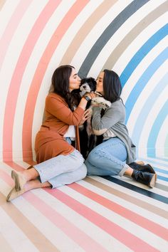 """""""They've never had professional photos done, so this seemed like the right time to do it!"""" The post """"Just because"""" plant shop photo session with rainbow wall celebrates love and a new puppy appeared first on Equally Wed, modern LGBTQ+ weddings + LGBTQ-inclusive wedding pros. Save The Date Photos, Rainbow Wall, New Puppy, Photo Sessions, Cute Puppies, Equality, Plant, Romantic, Weddings"""