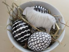 Graphic black and white patterned easter eggs.  Love the use of hay or straw ; so organic!