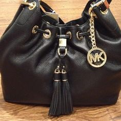 NWT Michael Kors Camden large shoulder tote Brand new Michael Kors large drawstring shoulder tote. Crafted in soft Venus leather. Chic tassels pull together a luxe bag.  10' drop double handles.  Drawstring closure with snap tab.  Exterior has gold tone hardware. Internet features 1 zip pocket, 3 open pockets, 1 cell pocket, & a key fob.  14 1/2W x 8 1/2H x 5 1/2D Michael Kors Bags Shoulder Bags