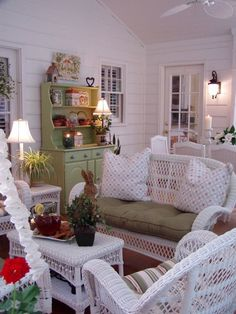 how cold you not want to sit down on this beautiful porch and have some sweet tea? Looks like a Southern porch to me.
