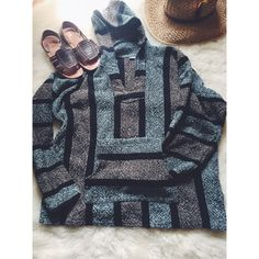 Mexican Blanket Style Hooded Poncho Perfect to throw on for a bonfire on the beach! This is the perfect warm weather staple with jean shorts and sandals! Gorgeous colors and an amazing oversized fit. Gently used. Good condition. Sweaters Shrugs & Ponchos