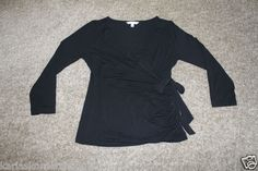 """Excellent used condition CAbi Womens Black V Neck Faux Wrap Long Sleeve Shirt Top Size Medium Bow on side of shirt can be removed and gathers at side 94% Rayon and 6% Spandex Pit to pit 17"""" and from shoulder to hem 22 3/4""""  Returns accepted if not 100% satisfied ( No hassle return policy) *Returned in same condition you received it in. *I pay for returned shipping if it is my fault *If it is your fault you pay for returned Shipping  FAST SHIPPING!!!."""