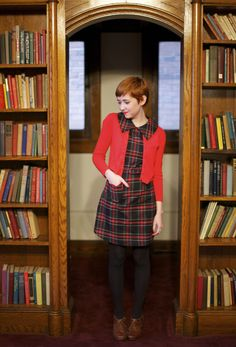I love how dramatic this plaid collar looks when layered over a bright red cardigan and, of course, it's hard to resist the allure of a cat-shaped pocket.