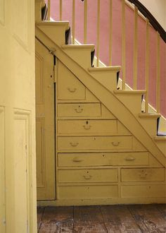 A cupboard under the stairs.... brilliant mix of colors too.