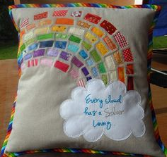 Rainbow pillow. Minus the binding...minus the cheesy slogan...a slightly more retro color palette...and I love it. If I ever get the guts to do a subtly rainbow-themed kids' room...