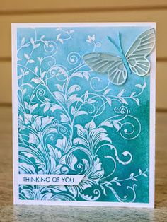 """SSS Wednesday Challenge / Fusion Challenge  Hero Arts Stamp """"Leafy Vines"""" heat embossed in white, sponged the background with Peacock Feathers Distress Ink. Added a shimmery butterfly die cut on top of a vellum solid one and the sentiment."""