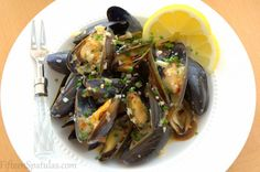 Mussels in a white wine garlic sauce.  Serve with crusty bed for soaking up the leftover sauce.  Mmm!