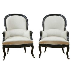 Pair of French Antique Napoleon III Ebonized Bergeres, c. 1860
